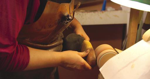 Bespoke Shoemaker Smoothing Leather Whilst Making Shoe Footage