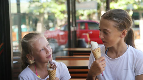 Young girls eating ice cream outdoors Footage