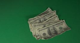 Bundle of dollars falling down Footage