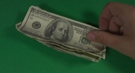 Hundred-dollar bill put in the pile (green background, chromakey) Footage
