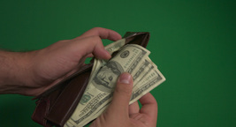 Purse with hundred dollar bills (green background, chromakey) Footage