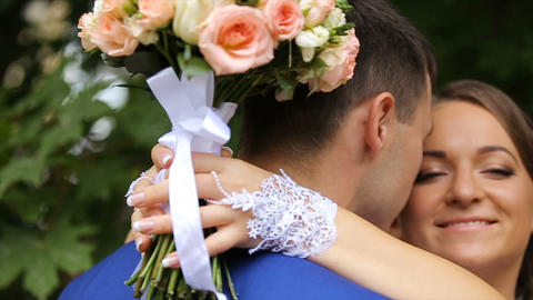 bride and groom in an embrace in the park Footage