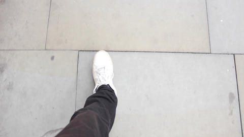 Feet walking on the street with white shoes POV ビデオ