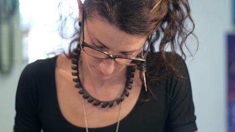 Jewelry maker closeup slide Live Action