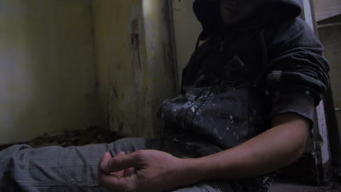 Junkie asleep or in overdose in an abandoned building closeup Live Action