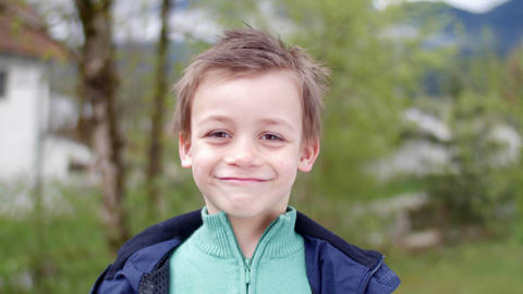 Simpathic Kid Smiling In Camera stock footage