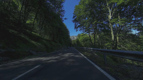Driving through secondary roads mountains and woods in summer Footage