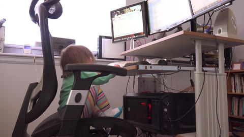 Toddler on professional 3 monitor computer server business workstation Footage