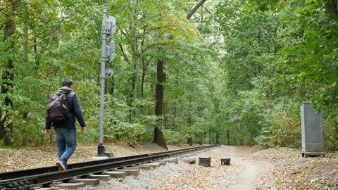 Man walks between railway rails Footage