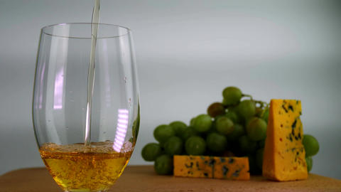 White Wine Poured in Glass Footage
