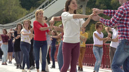 Latin dance. People dance in the street. Slow motion Footage
