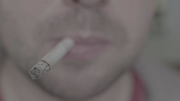 The smoker smokes a cigarette (close up) Footage
