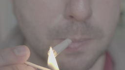 The smoker lights a cigarette (close up) Footage