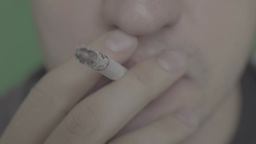 Cigarette with ashes Smoking in the smoker's mouth (close up) Footage