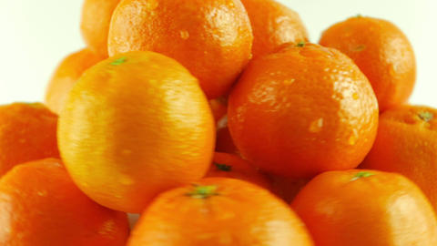 Macro Shot of Rotating Tangerines - White Background Footage