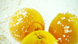 4 Oranges Splashed into Water - Ultra Slowmotion Footage