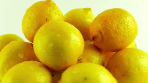 A Group of Fresh Lemons Rotating Against a White Background Footage