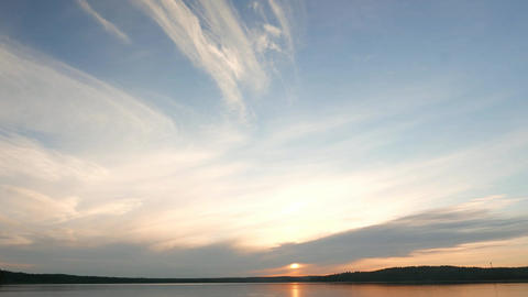 Light stretched clouds over evening sky, lake sunset skies time lapse shot Footage