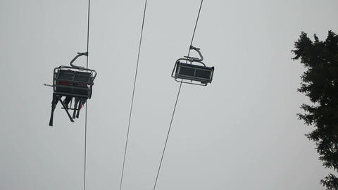 Ski chair lift with skiers Footage