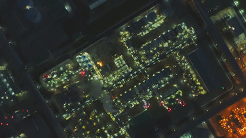 Drone Rotates over Large Enlighten Plant at Dark Night Footage