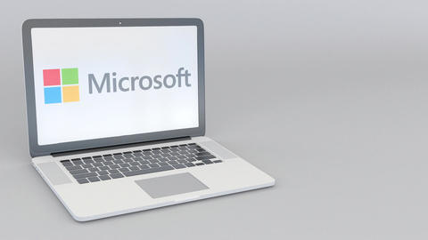 Rotating opening and closing laptop with Microsoft logo. Computer technology Footage