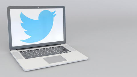 Rotating opening and closing laptop with Twitter, Inc. logo. Computer technology Footage