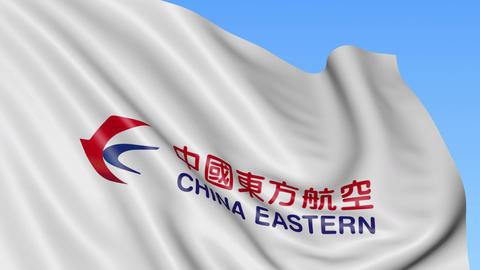 Waving flag of China Eastern Airlines against blue sky background, seamless loop Footage