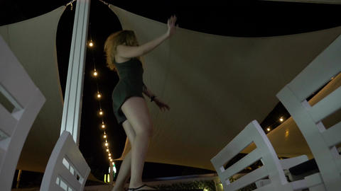 Drunk woman trying to dance at the pole dancing in the night club fooling around Footage