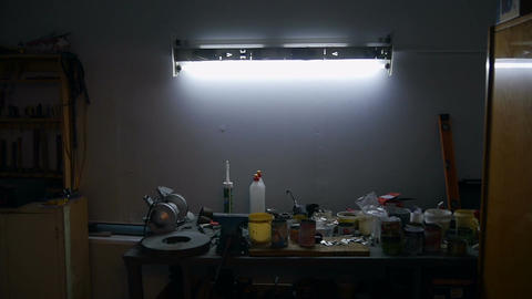 Light slowly turns on above the workbench Footage
