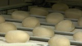 german bakery roll bun on conveyor belt close 10743 Footage