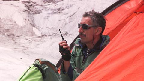 Man with portable radio Stock Video Footage