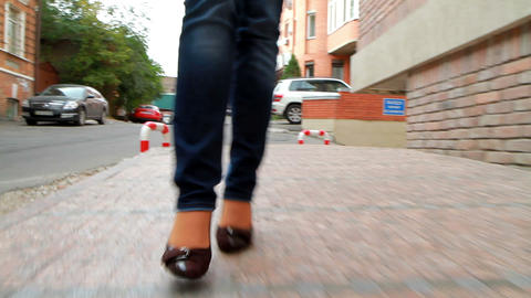 Leggy girl goes through the streets of the city Stock Video Footage