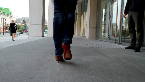 Tall, leggy girl goes through the city Stock Video Footage