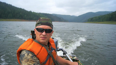 Mature man in the motor boat floating Stock Video Footage