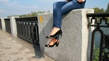 girl sitting on the parapet and waved his feet Footage