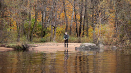 fisher on the river Stock Video Footage