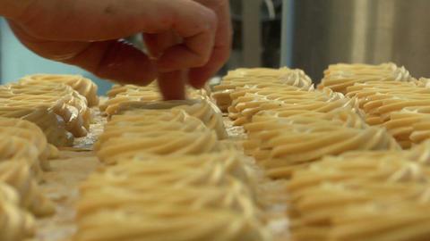 german bakery make holes in cake 10748 Stock Video Footage