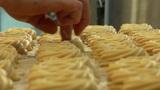 german bakery make holes in cake 10748 Footage