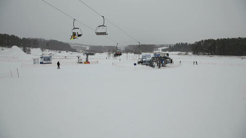 Ski chair lift with skiers Live Action