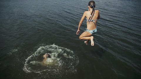 Girls jumping into the lake Footage