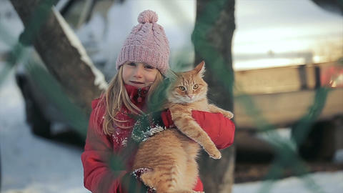 Young girl with a cat on a winter day Footage