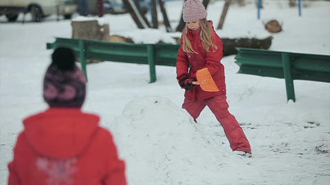 Child plays with snow Footage