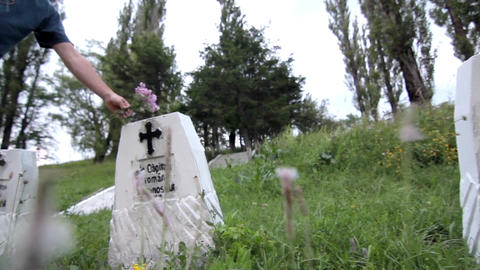 Man placed a bouquet of flowers on a grave cross of unknown soldier 17b Footage