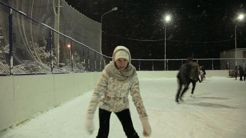 Young girl on ice skating at the rink Footage
