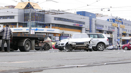 Car accident aftermath, broken front part of vehicle, stand in middle of road Footage