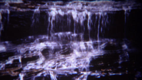 1943: Family picnic at scenic autumn cascading waterfall location Footage