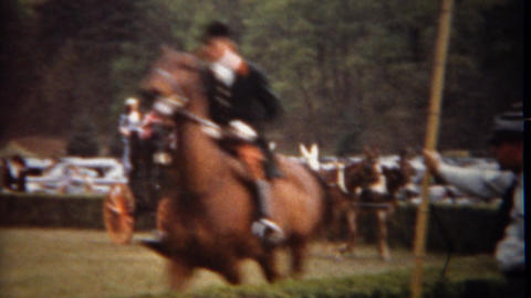1944: Fox hunting equestrian horse riding expo trotting around track Footage