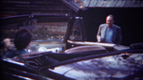 1943: Woman driving convertible car smoking cigarette waiting Footage