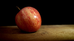 Red Apple against black backdrop HD stock footage Footage