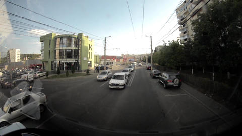 View From The Bus Windshield Running Through A Neighborhood Of Apartment Buildin stock footage
